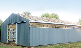 blue metal barn in the process of being built