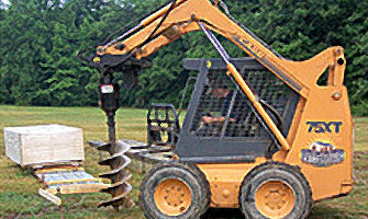 skid loader drilling into the ground