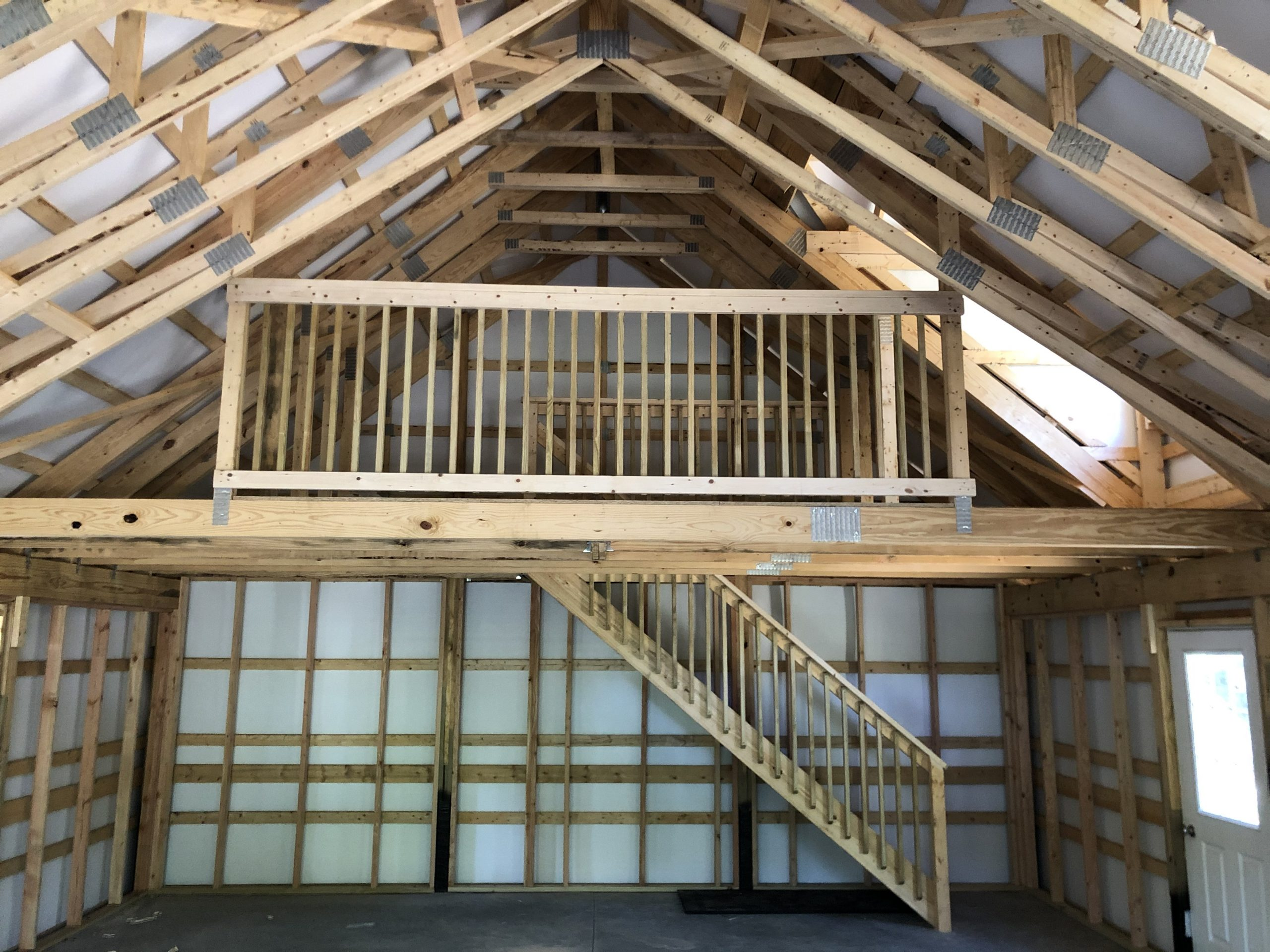 two story interior of post frame barn