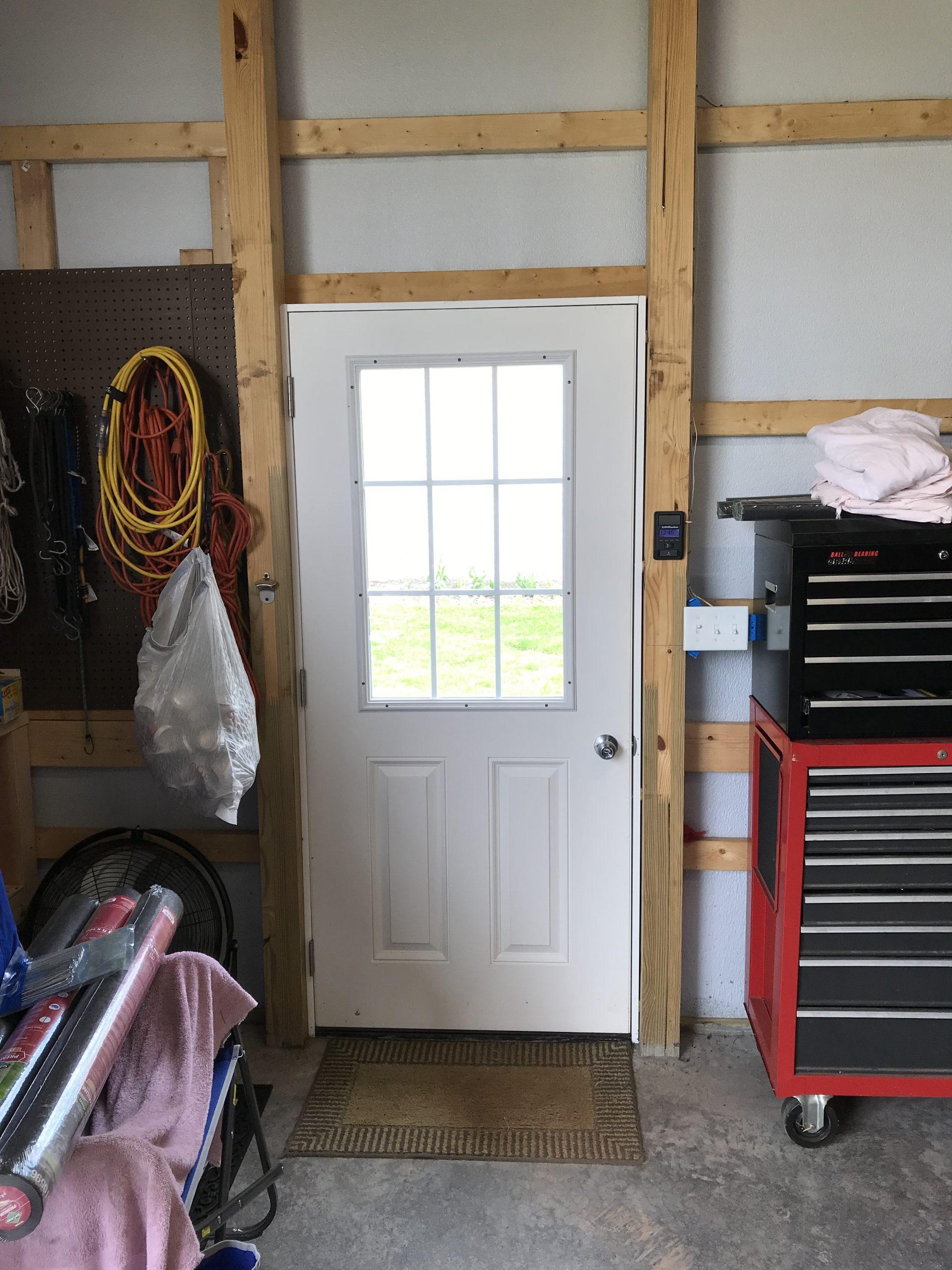 new door installation in pole barn garage