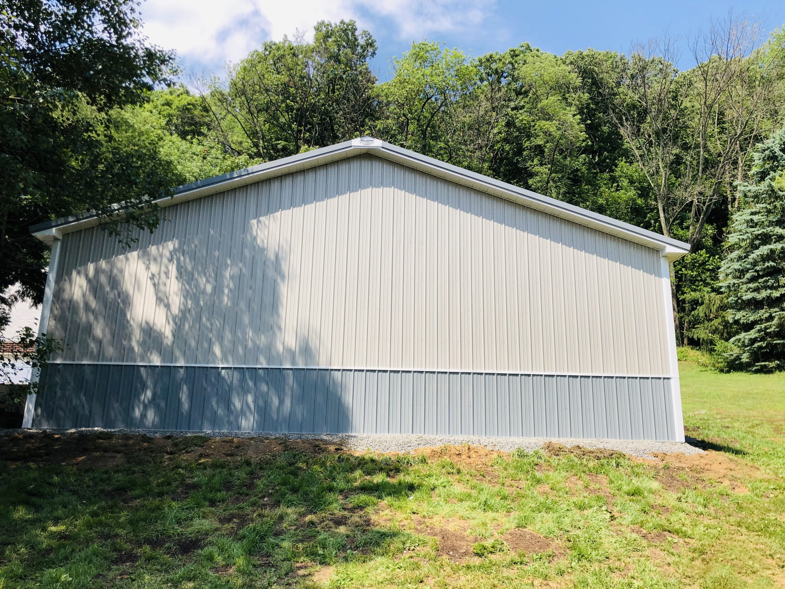 white and blue metal siding on new pole building
