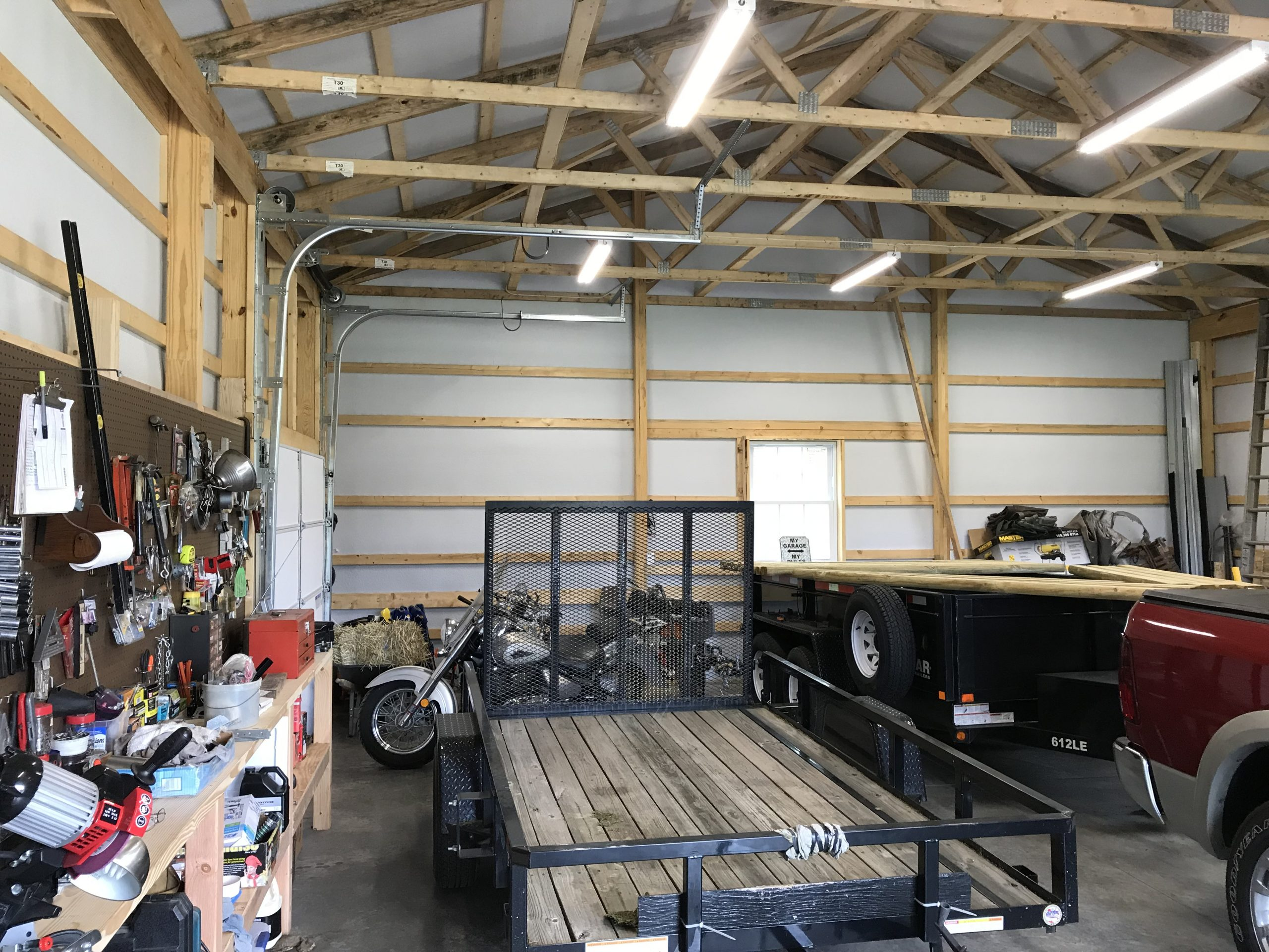 interior shot of a pole garage with car and tools