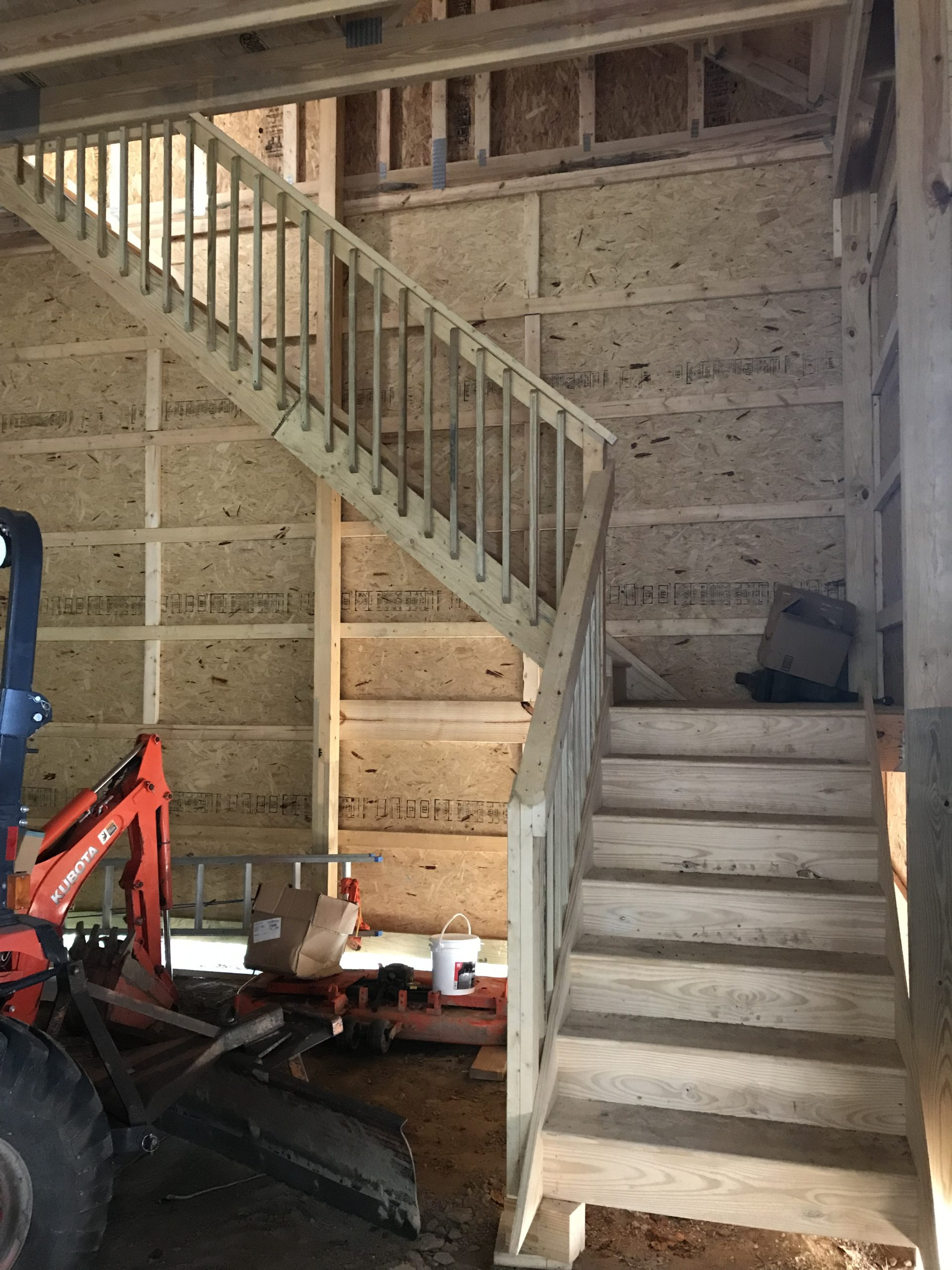 wooden staircase in post-frame garage