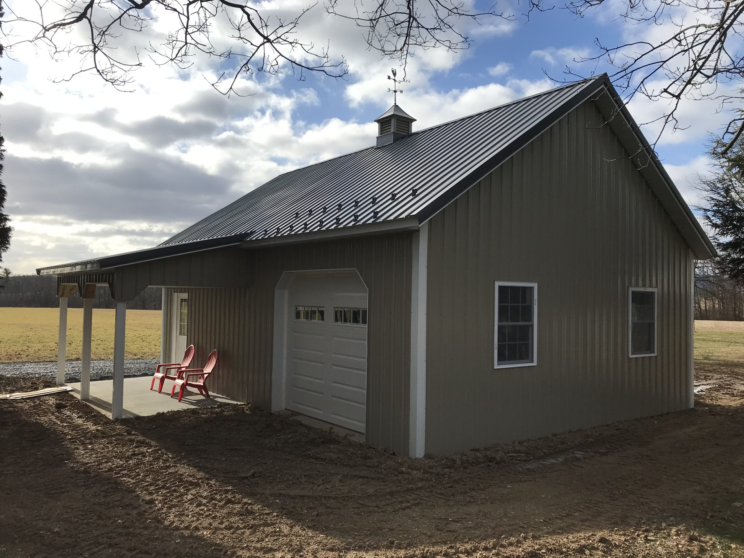 new a-frame residential pole garage with small attached porch
