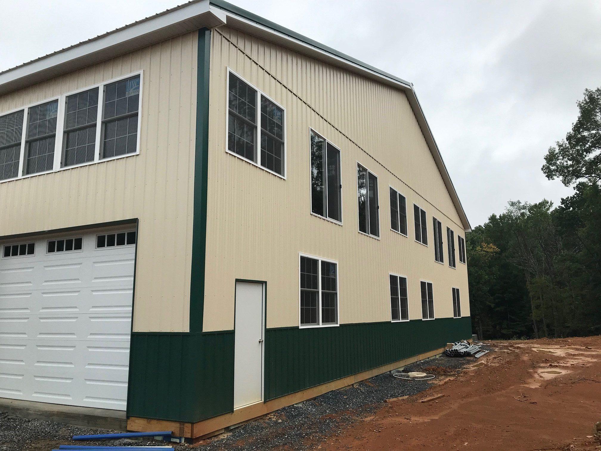 tan and green metal siding on new pole barn garage
