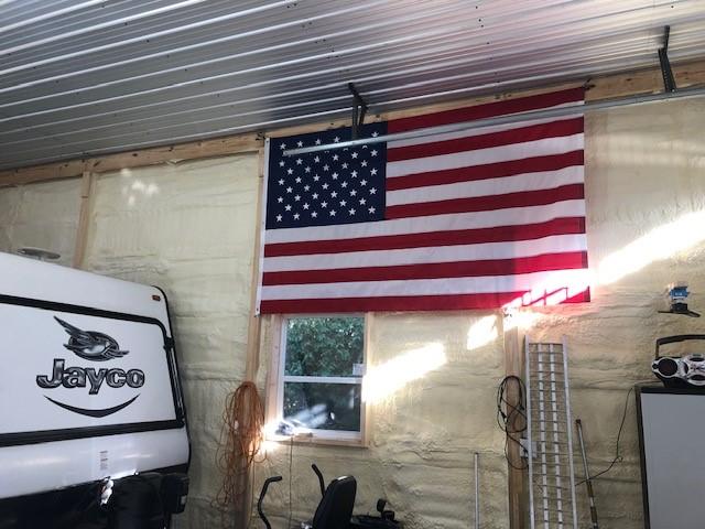 American flag hung in pole barn garage