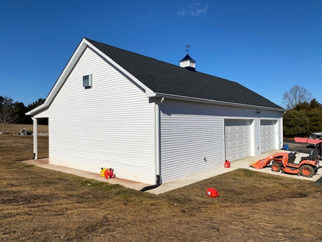 residential garage with cupola